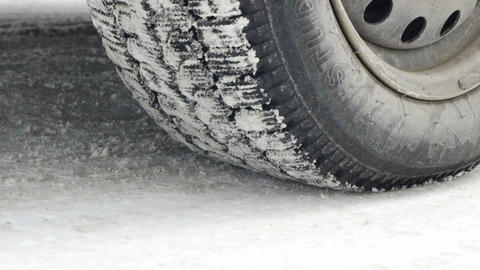 Car starts drifting wheel closeup on snowy road Stock Video Footage