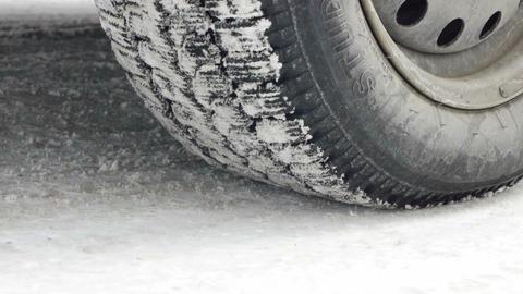 Car starts drifting wheel closeup on snowy road Stock Video Footage