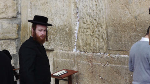 Pilgrims praying near Western wall, Jerusalem, Isr Stock Video Footage