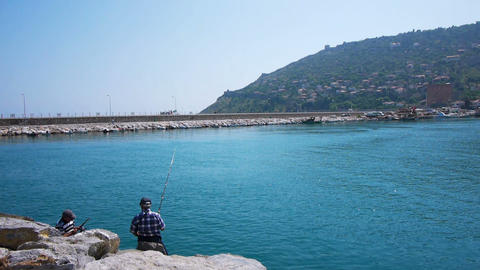 Two Senior Men Fishing On Sea Shore, Alanya, Turke stock footage