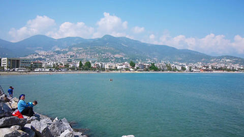 Mediterranean sea shore with fishermen in Alanya,  Footage