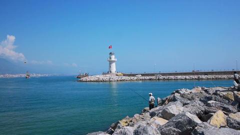Senior men fishing in Alanya bay near lighthouse Stock Video Footage
