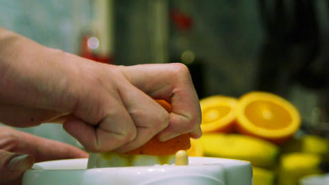Squeezing fresh juice out of ripe tasty oranges an Stock Video Footage