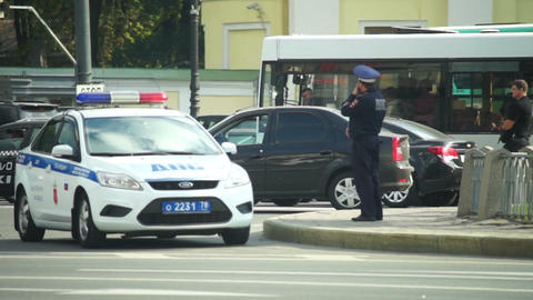 Patrol policeman staying near police car in Saint  Footage