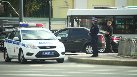 Patrol policeman staying near police car in Saint Stock Video Footage