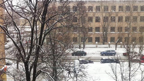 Snowfall on city street, high angle view Stock Video Footage