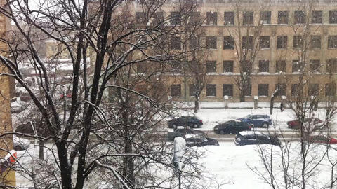 Snowfall on city street, high angle view Footage