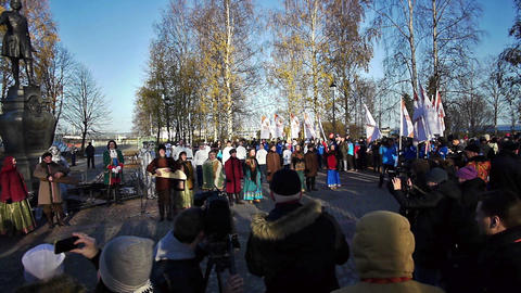 Kantele folk ensemble acting in front of spectator Stock Video Footage