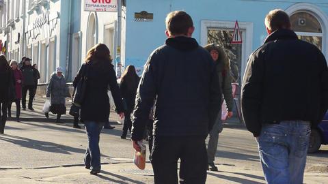 PETROZAVODSK, RUSSIA -April, 13: Pedestrians cross Footage