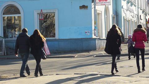 PETROZAVODSK, RUSSIA -April, 13: Pedestrians cross Stock Video Footage
