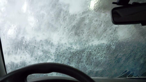 Inside view on windscreen during washing Stock Video Footage
