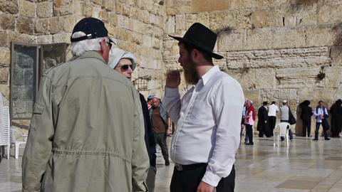 Street conversation between tourists and Jerusalem Footage