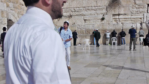 Many people with white kippah near Western Wall, J Footage