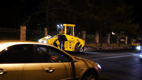 Road works in big city at late evening Stock Video Footage
