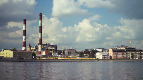 Large factory with chimney-stalks on city quay Stock Video Footage