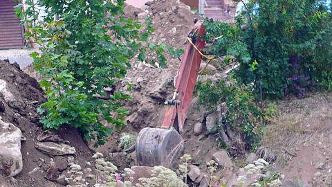 Excavator earth mover working, close-up view Live Action