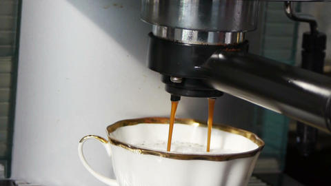 Making a cup of espresso coffee slider shot Footage