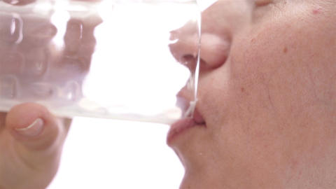Woman Drinks Milk Turn And Smiles stock footage