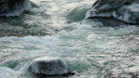 4K UHD Icy Rocks in a Mountain River Footage