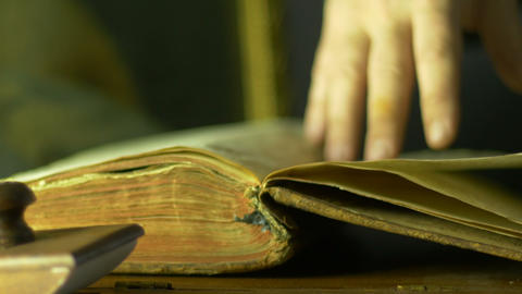 4K UHD Study Of Ancient Book Flipping Pages Macro stock footage
