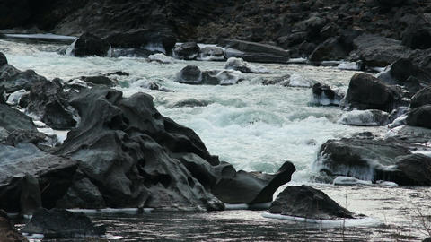 HD Iced Black Rocks in a Mountain River Footage