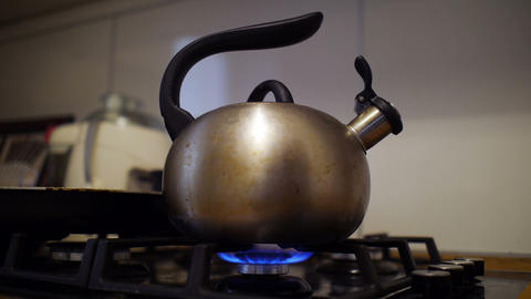 Turning On And Off Flame Under Teapot stock footage