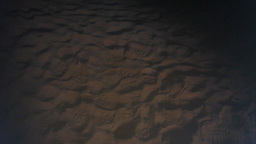 Night scene of footprints in the sand Footage
