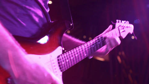 rock concert: guitarist playing solo (medium shot) Footage