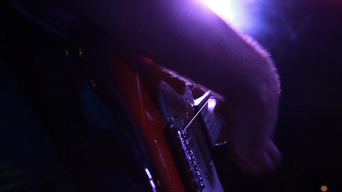 a low angle during a solo on electric guitar during the concert Footage