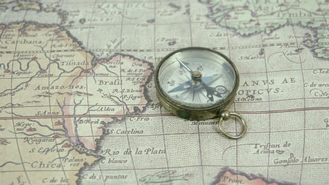 Zoom out view of the compass and the map Footage