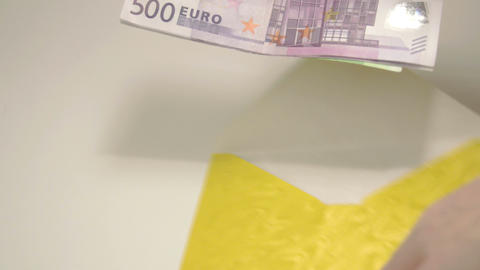 Some Euro bills inside the yellow envelope Footage