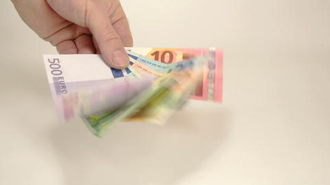 Some Euro bills waved by the mans hand Live Action