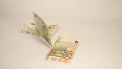 Seven 50 Euro bills dropping on the table Live Action