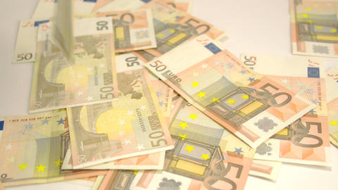 Lots of 50 Euro bills on the floor Live Action