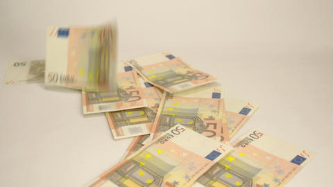 Seventeen 50 Euro bills thrown on the table Live Action