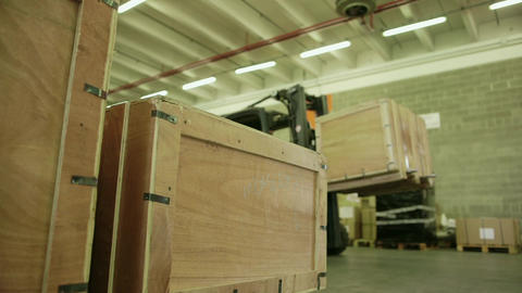 Worker on forklift arranging boxes in warehouse Footage