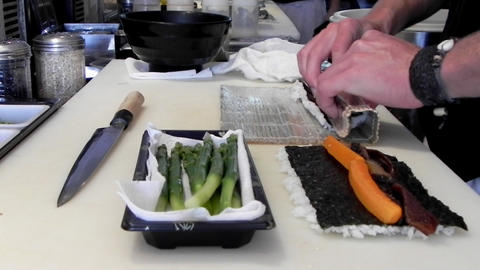 Japanese gourmet asian seafood Restaurant food Chef preparing sushi salmon fish rice Footage