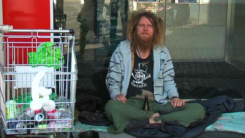Street tramp 1 Stock Video Footage
