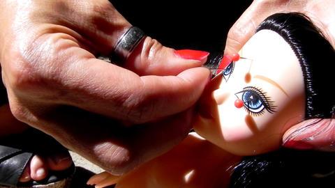 voodoo burn doll spells witch needle anger punishment cruel Stock Video Footage