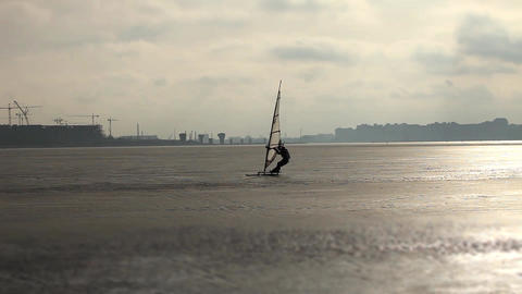 windsurfer ice surfing Live Action