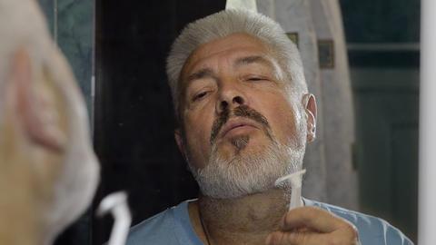 Elderly Man Shaving And Performing Various Groomin stock footage