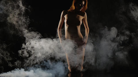 Young Girl Posing Nude, Naked In Smoke, Slow-motio stock footage