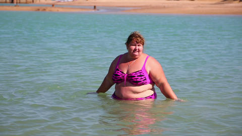overweight woman bath in sea Footage