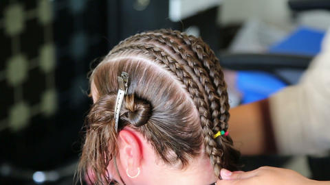 Hairdresser Hands Weaving A Dreadlocks For Little  stock footage