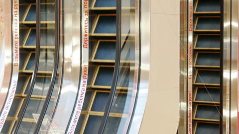 Up And Down Moving Escalators In Public Building stock footage