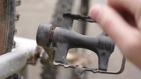 Fixing A Bicycle Pedal Spinning stock footage