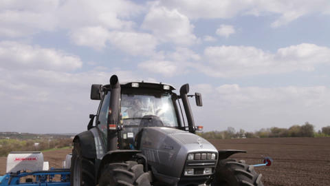 Tractor Stands On The Field With A Drill stock footage