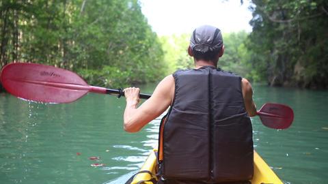 man kayak rowing kayak on the river Footage