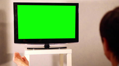 Surfing television channels. TV green screen Live Action
