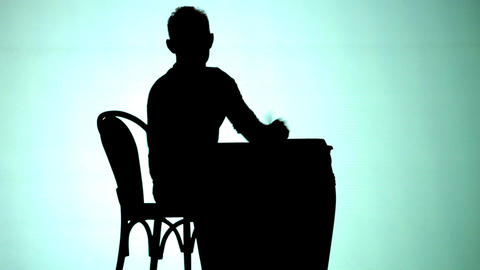 Silhoutte of Man playing drums Live Action